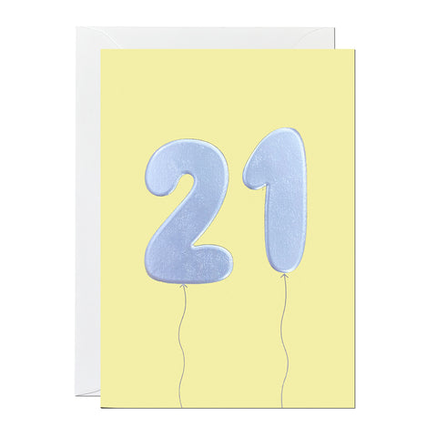 An 21st birthday card featuring big helium balloons printed with an embossed silver foil on a yellow card.