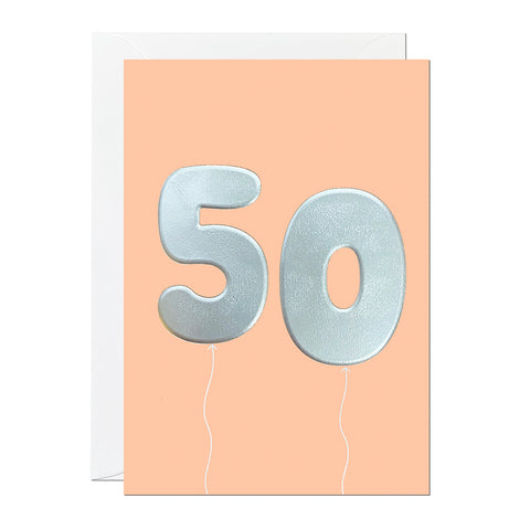 An orange 50th birthday card that has been printed with an embossed silver foil