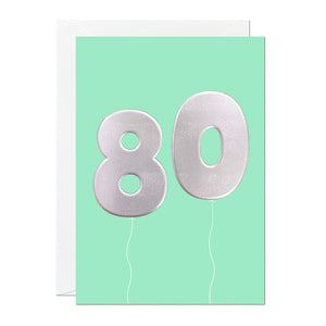 A green 80th birthday card that has been printed with an embossed silver foil