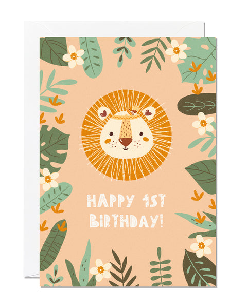 A children's 1st birthday card with the greeting 'happy 1st birthday' featuring an illustration of a lion with jungle foliage around the border