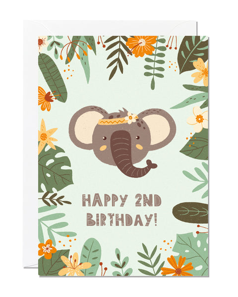 A children's 2nd birthday card with the greeting 'happy 2nd birthday' featuring an illustration of an elephant with jungle foliage around the border