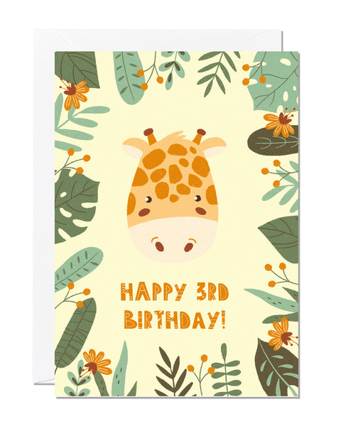 A children's 3rd birthday card with the greeting 'happy 3rd birthday' featuring an illustration of a giraffe with jungle foliage around the border