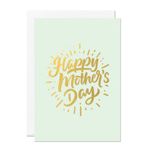 This is a Mother's Day card that says 'Happy Mother's Day'. It's printed with a light green background and features hand lettering printed with a luxury gold foil