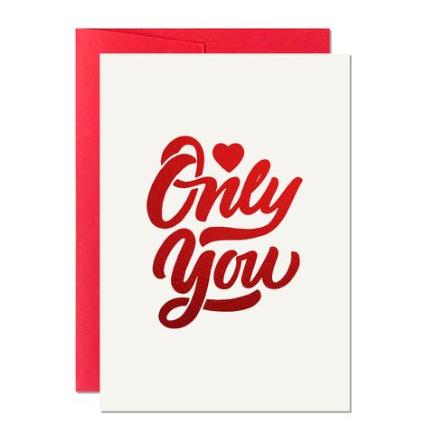 This is a greeting card that says 'Only You'. It's perfect for Valentine's Day and Anniversary and it features hand lettering printed with a luxury red sparkly foil
