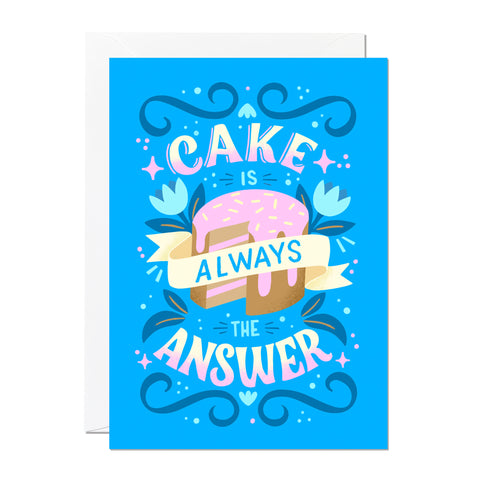 This birthday card has a greeting that reads 'cake is always the answer' and features a blue background with hand lettering and illustration.