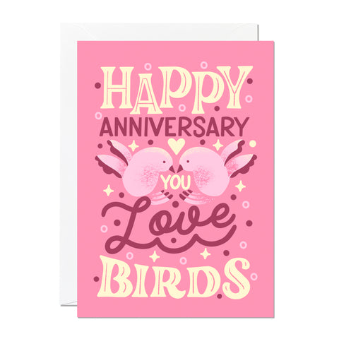 This is an anniversary card by Ricicle Cards. It reads 'happy anniversary you love birds' and features hand-lettering and illustration set on a light pink background.