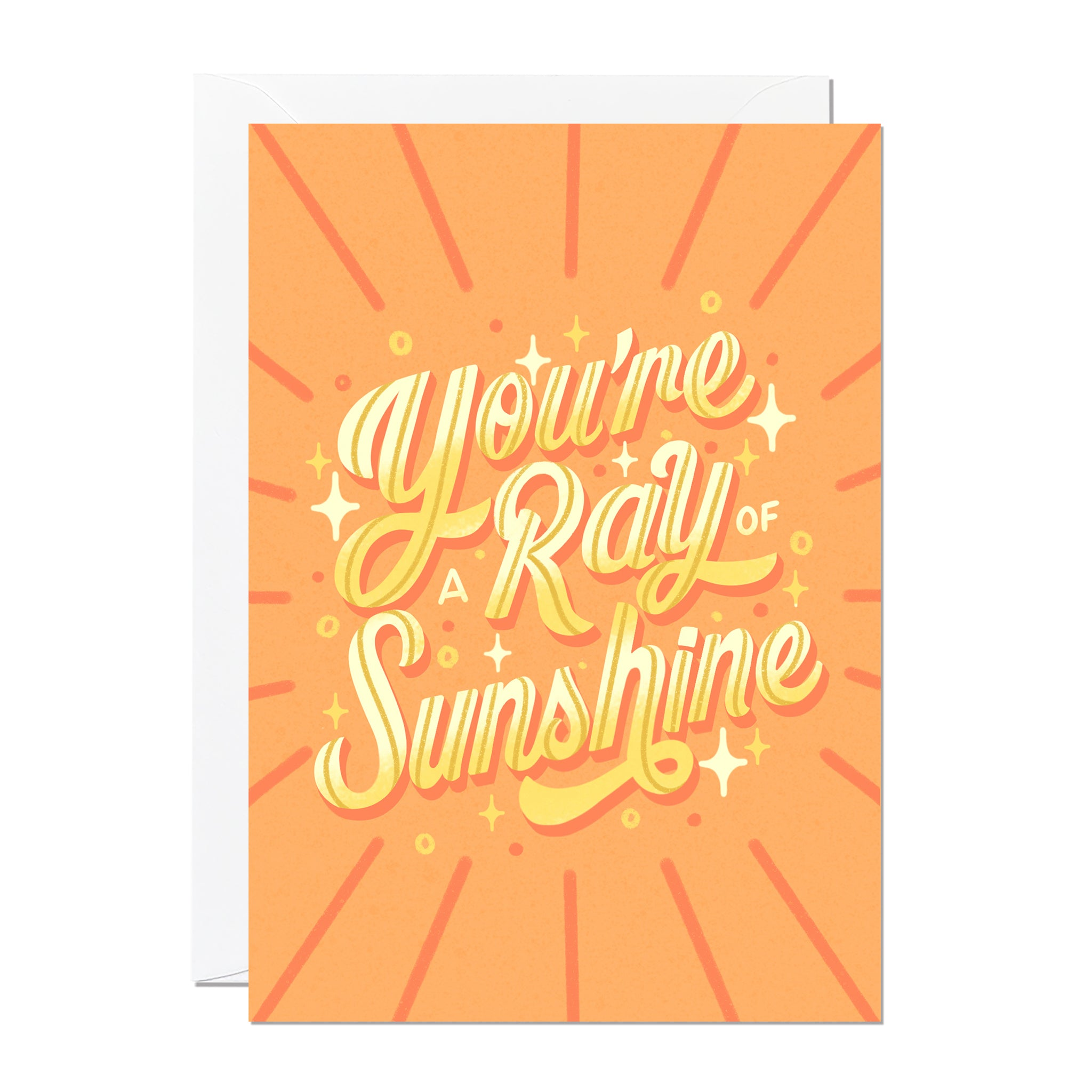 This greeting card features hand-lettering by Roselly Monegro and says 'you're a ray of sunshine'. It's set on a orange and yellow background and is printed in the UK.