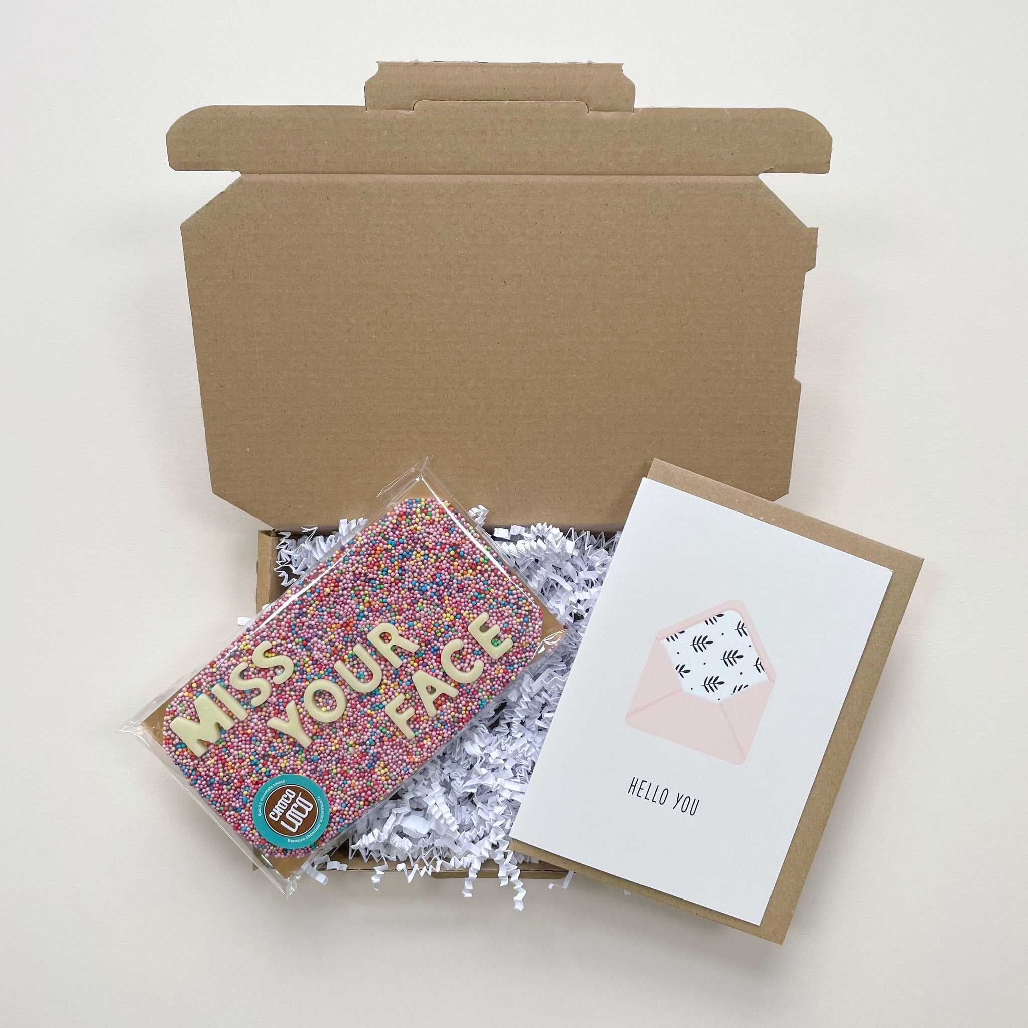 This Miss Your Face gift box contains a bar of Belgian chocolate that spells 'Miss your face' and is accompanied with a Ricicle Cards 'hello you' greeting card.
