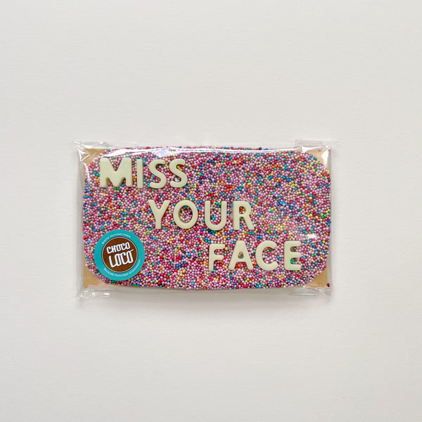 This 'miss your face' chocolate bar is made with Belgian chocolate, has hundreds and thousands sprinkles and white chocolate lettering spelling out 'miss your face'.