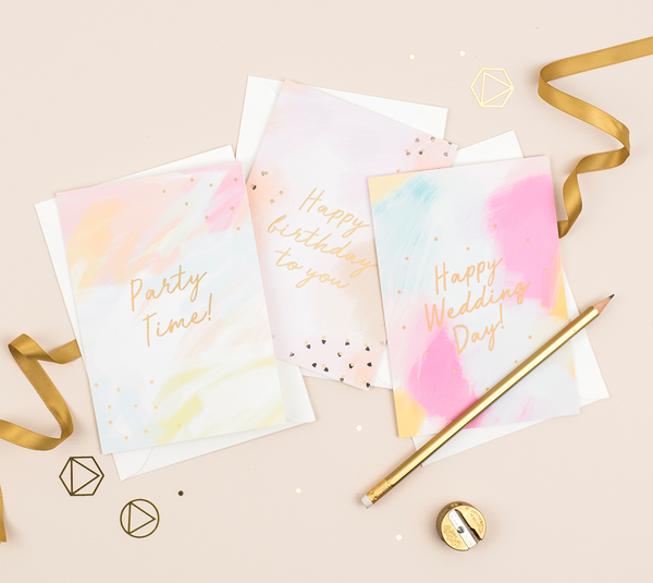 A birthday card which features a hand-painted canvas background with a gold foil greeting that reads 'party time'