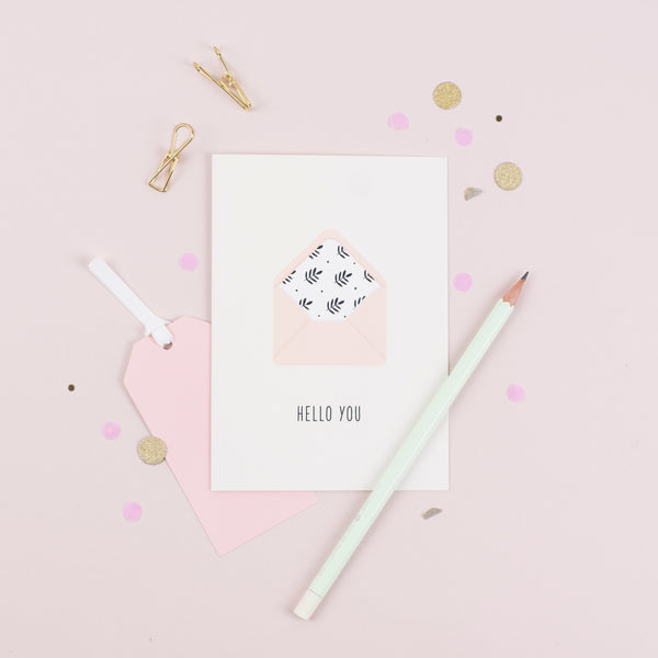 A greeting card with an illustration of a pretty pink envelope and a greeting that reads 'hello you'