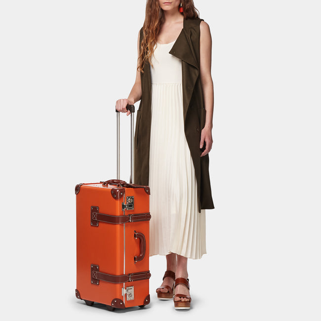 The Anthropologist Stowaway in Orange - Vintage Style Leather Case - Exterior Front with Model