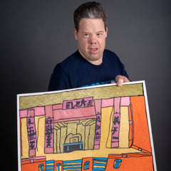 """Photograph of visual artist, David Wright holding his drawing titled, """"Chinese Theater""""."""