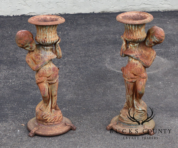 Antique Pair of Cast Iron Garden Statue Planters w/ Cherobs Holding Urns