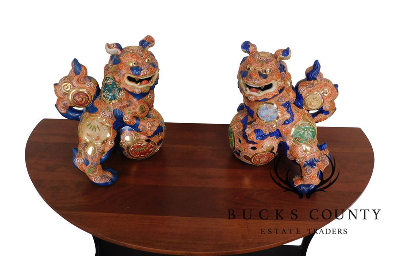 Pair of Earthenware and Enamel Decorated Foo Dog Figures