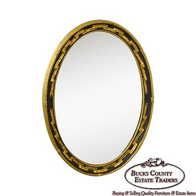 Friedman Bros. Oval Gilt Regency Style Beveled Wall Mirror