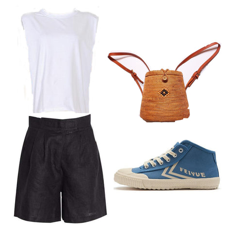 padded shoulder muscle tee, black high waist shorts, blue sneakers, woven backpack.