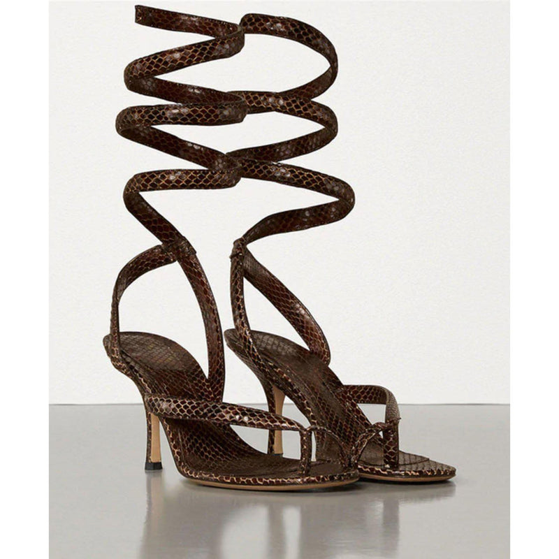 brown snake print heeled thong sandals with spiral ankle wrap detail.
