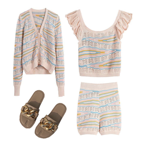 women's wear outfit including a v-neck cardigan, sleeveless knitwear top and matching knit shorts with a pair of slip on sandals with chain detail.
