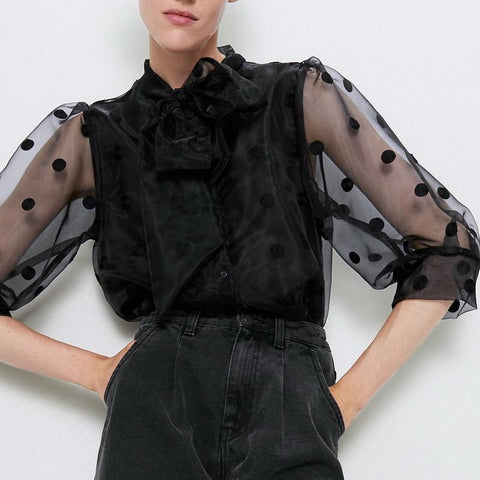 Sheer polka dot blouse with ruffle front