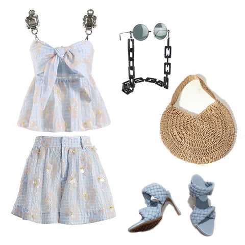 Blue embellished shorts and cami top set with light blue woven leather sandals and straw bag.