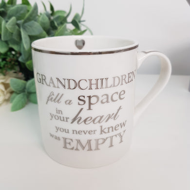 'Grandchildren fill a space in your heart' Mug