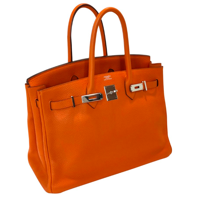 This iconic Hermès Birkin 35cm bag is featured in the popular Orange color, a shade synonymous with the Hermès brand.