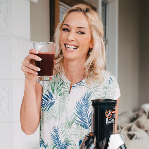 Lisa Raleigh drinking veggie juice with cold press juicer