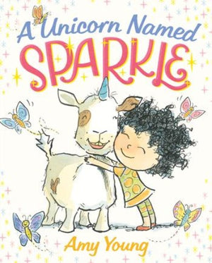 "Book cover of a ""unicorn"" with a blue horn being hugged by a girl with black curly hair"
