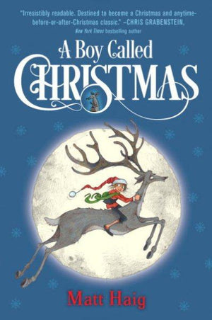 Book cover of the boy riding a reindeer with a moon and snowflakes
