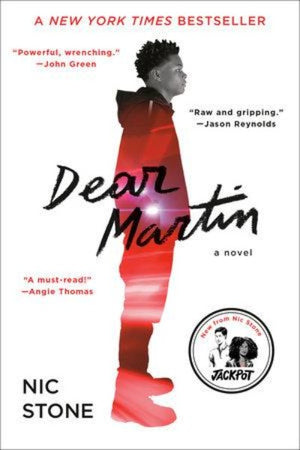 Book cover with African-American boy standing  in profile with  lights reflected red
