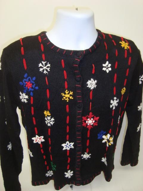 Black Ugly Xmas sweater with snowflakes and red gold blue accents