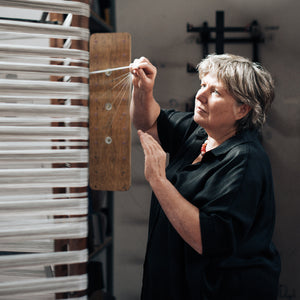 Anke McKernan making warp traditional weaving