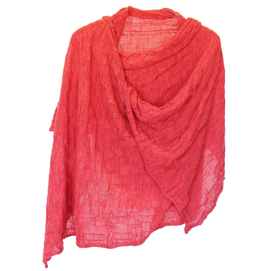 KIMIKO - a large shawl knitted from an overtwisted wool yarn which gives it a crunchy texture.
