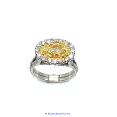 Platinum and 18k Yellow Gold Ladies Fancy Intense Yellow Oval Diamond Ring