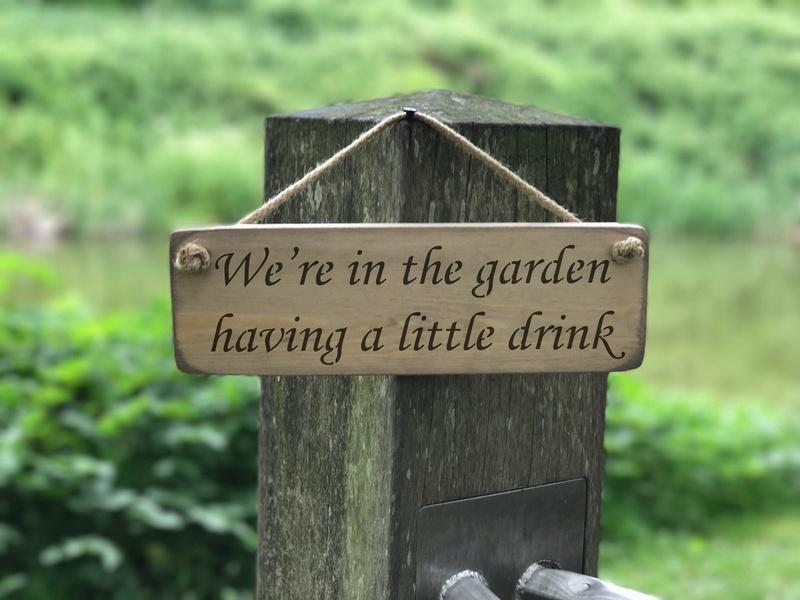 We're in the garden having a little drink small wooden sign - Daisy Park
