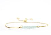 Baby blue glimmer beaded adjustable bracelet gold