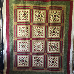 Free motion quilting on floral quilt