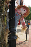 A Scarecrow Behind a Lamp Post