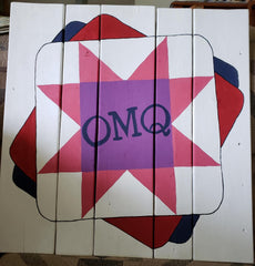 Barn quilt with One More Quilt logo