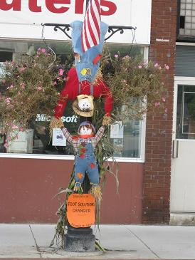 Two Scarecrows on a Lamp Post