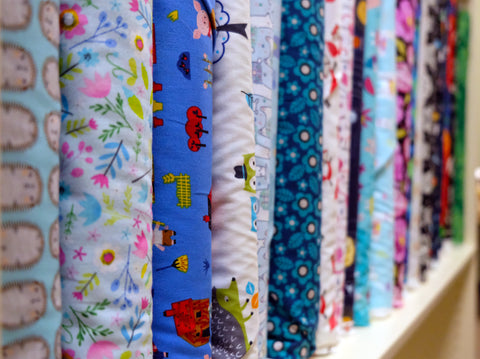 bolts of quilt fabric