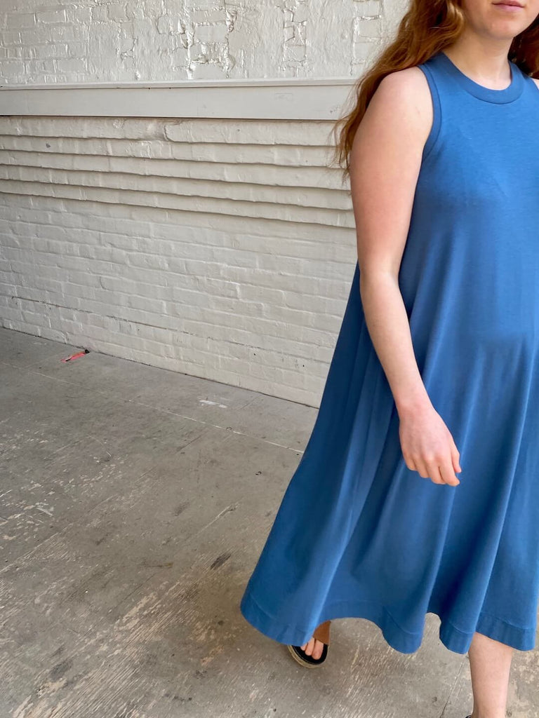 hoi bo sleeveless azure cotton dress falls below the knee. Made in Canada