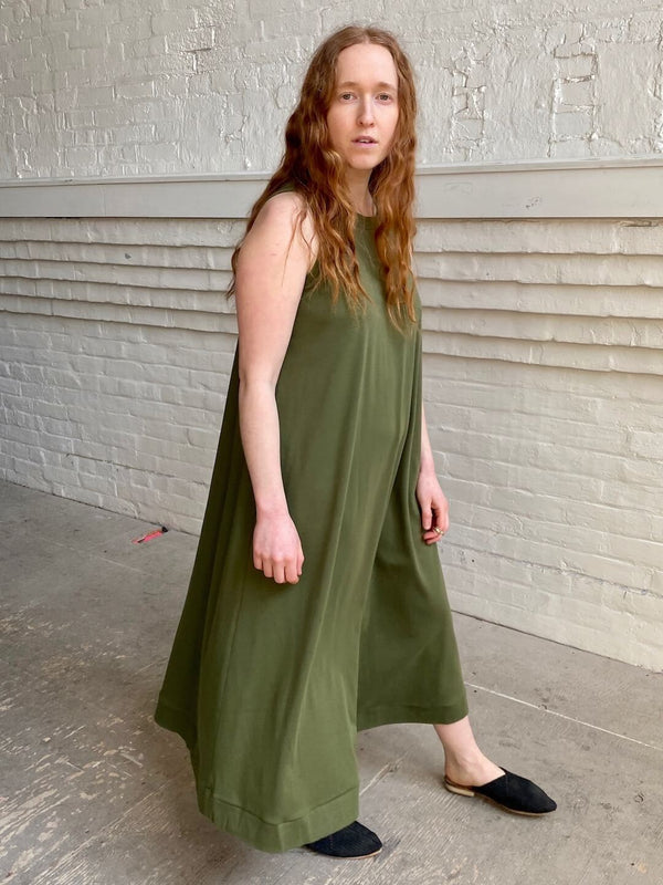 hoi bo sleeveless olive cotton dress falls below the knee. Made in Canada