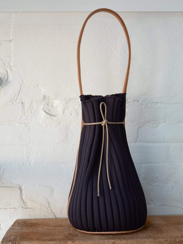 hoi bo shoulder tote made in canada with woven aubergine polyester and natural leather