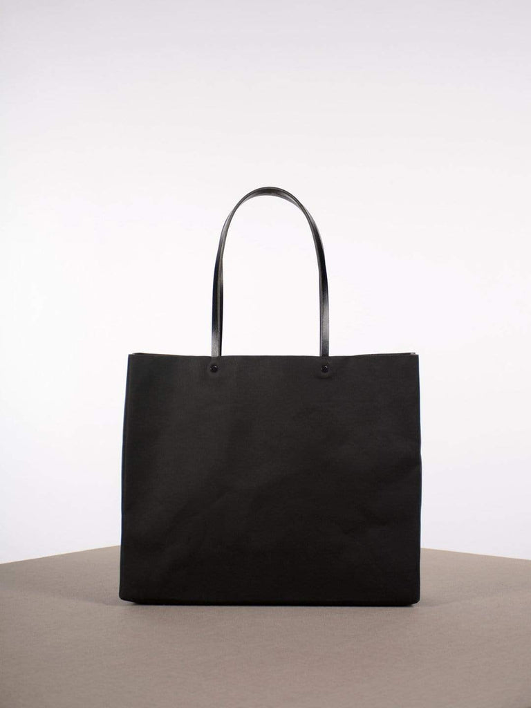 hoi bo black washable paper tote with black leather handles made in Canada
