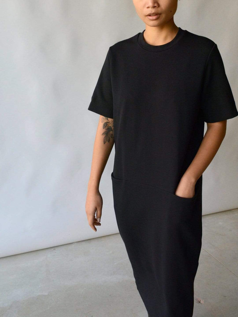 hoi bo black cotton nylon dress with short sleeves and front pockets made in Canada