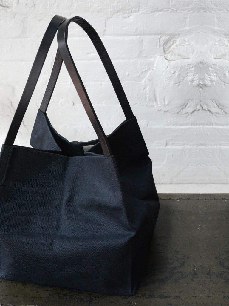 hoi bo black waxed canvas box tote bag with black leather handles made in Canada