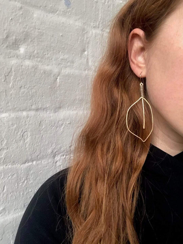 handmade brass leaf earrings with linen