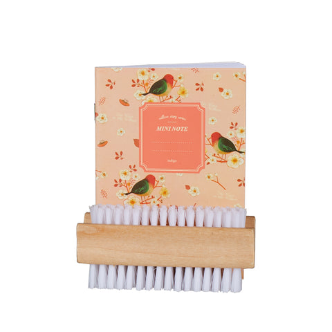 Image of Gardeners notebook and nail scrubber brush